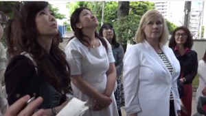 Kelly Hampton at Japan's Tree of Knowledge with students